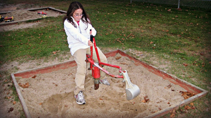 Janelle performs the Teamster Twister Dance on Gorham NH's  amazing sandbox Shovel Scooper.